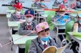 করোনাভাইরাস প্রাদুর্ভাব রোধে চীনের স্কুলে  ঐতিহাসিক টুপির ব্যবহার